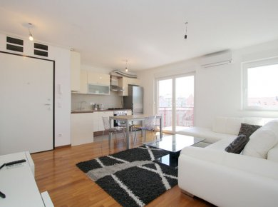 New, unused, furnished, 2-bedroom apt (65m2) with a balcony and a parking space